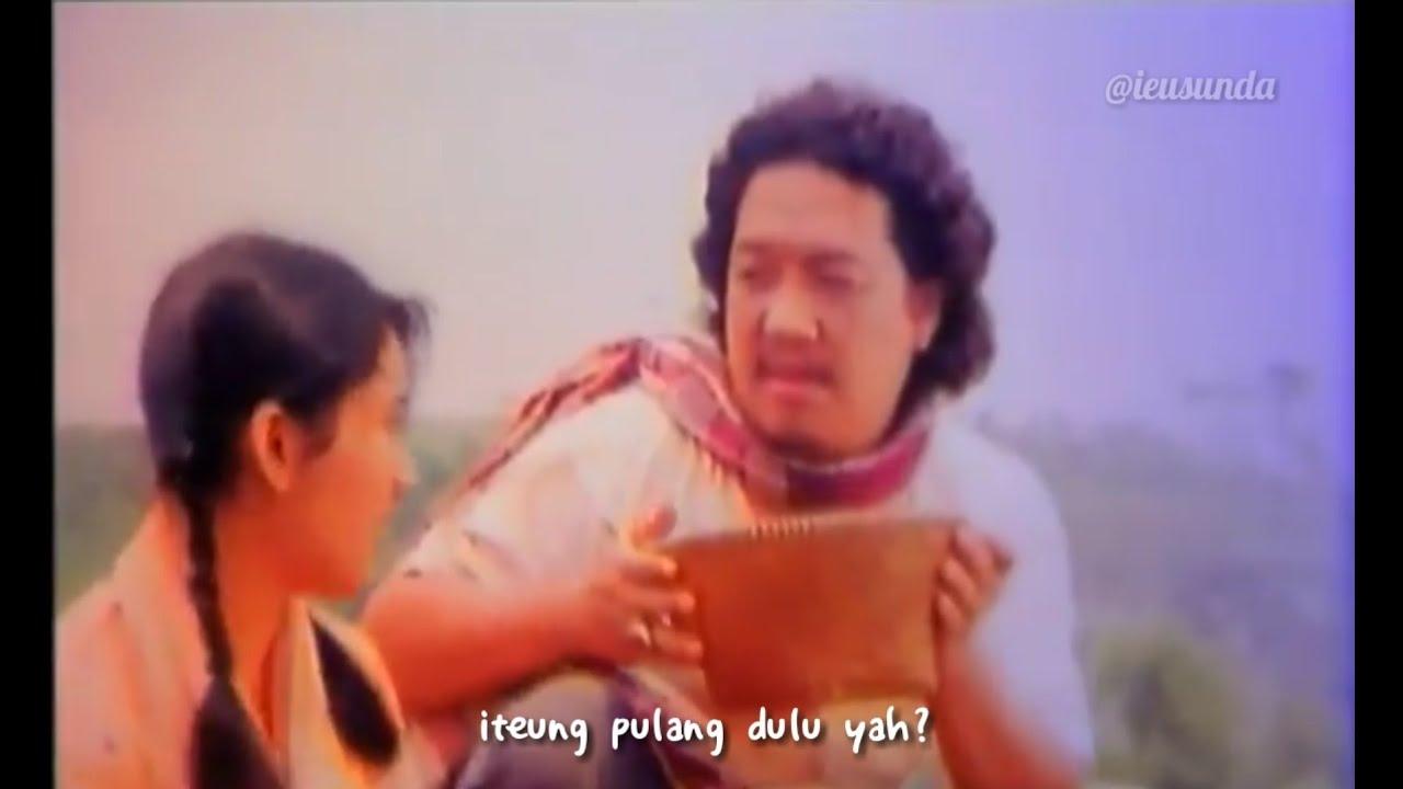 Selebritas Indonesia, Nike Ardila dan Didi Petet, memerankan Nyi Iteung dan Kabayan dalam film Si Kabayan Saba Metropolitan (1992).
