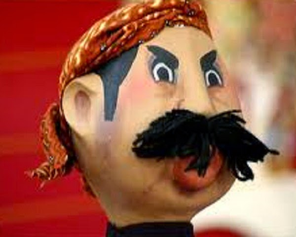 Boneka Pak Raden.