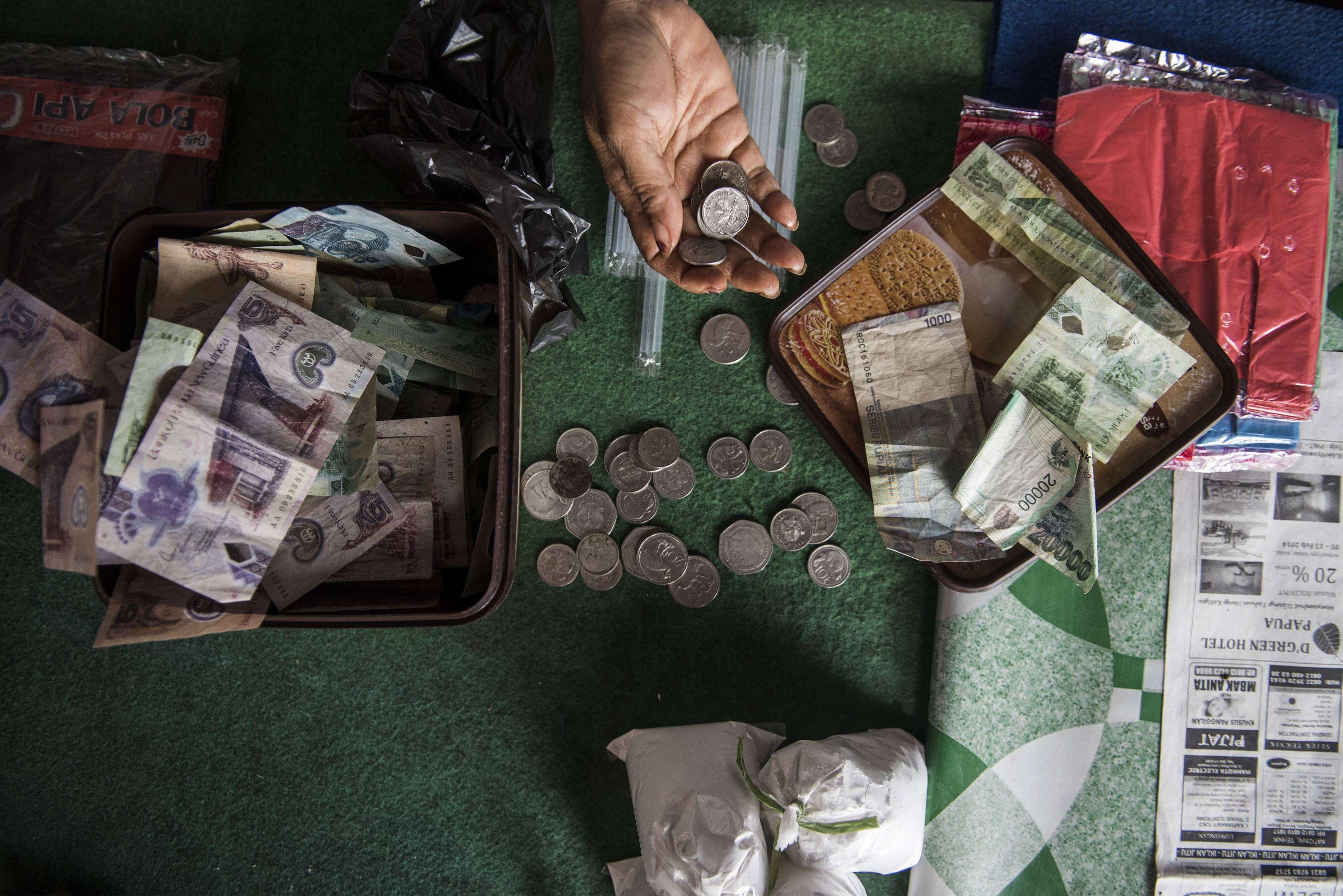 Uang Kina dan Rupiah