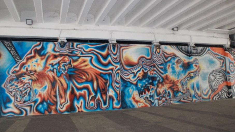 Lukisan dinding bergambar Singa, karya seniman luar negeri asal Jerman, Synder | Foto: Muhammad Arya Nugraha