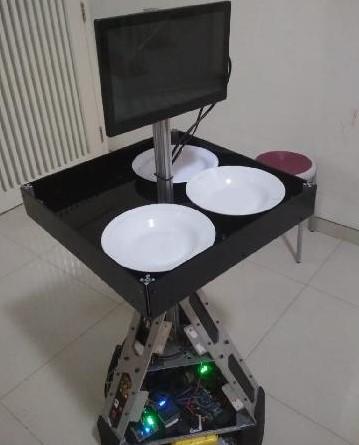 Prototipe robot pelayan yang dikembangkan oleh tim peneliti dari Institut Teknologi Sepuluh November (ITS) dan Rumah Sakit Universitas Airlangga (RSAU) Surabaya untuk membantu tenaga medis dalam merawat pasien virus corona. Foto: Tempo.co