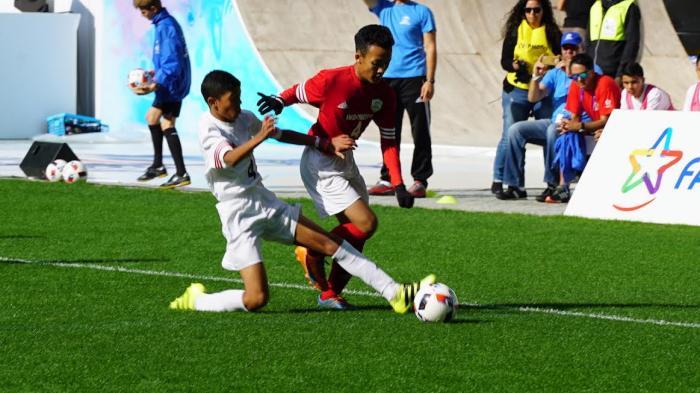 Yuga, salah satu penggawa Indonesia saat berjibaku dengan pemain Tunisia dalam perebutan peringkat 11 dan 12 di Final Dunia Danone Nations Cup 2016. Indonesia berhasil mengalahkan Tunisia 1-0 lewat gol dari titik putih. Foto: Istimewa