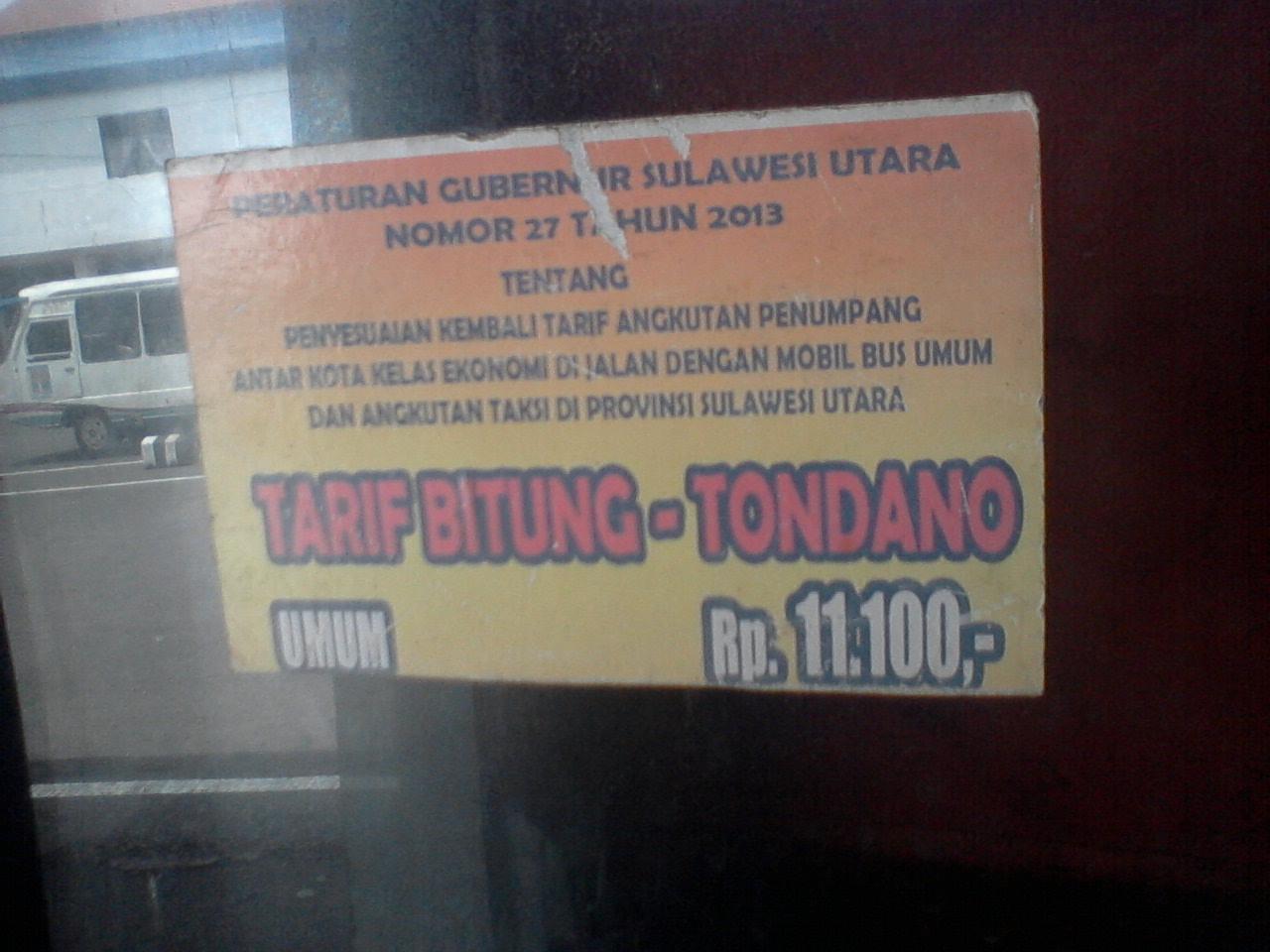 Stiker Tarif di Kaca Pintu Otobus